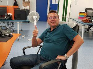André, notre expert audit, ici souriant à son poste